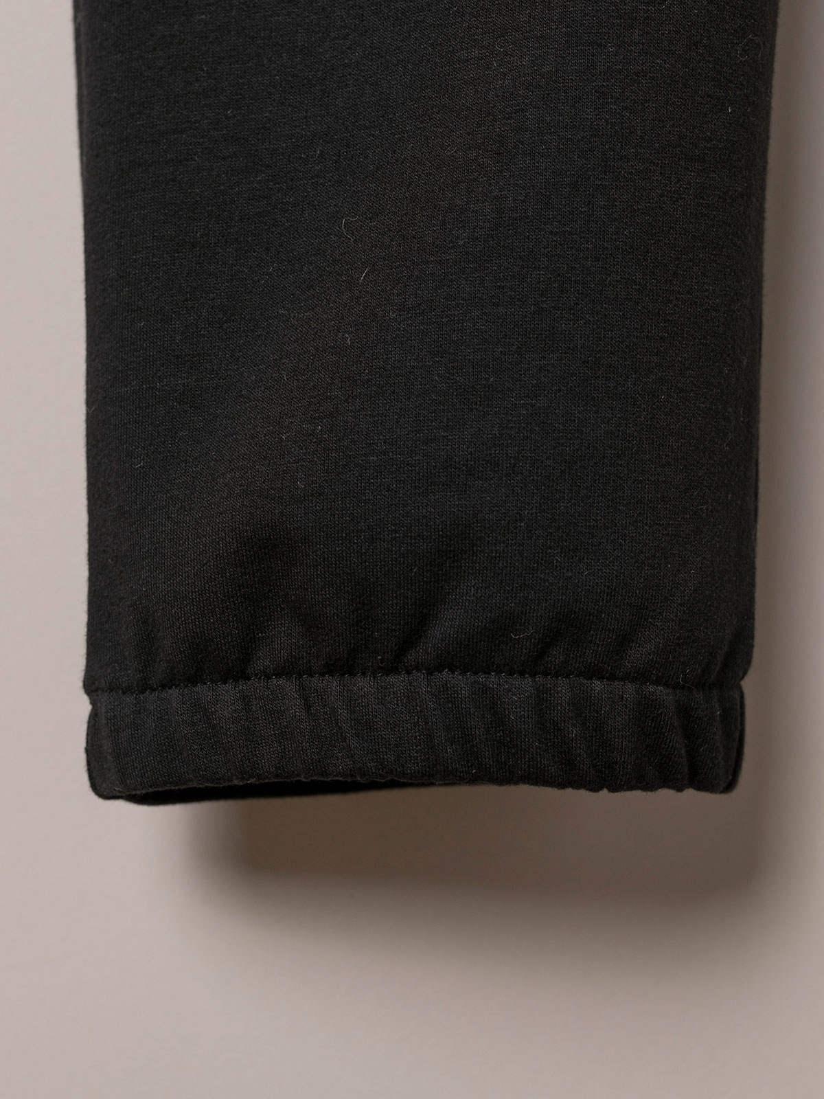 Pantalón mujer jogger detalle en bajo Negro