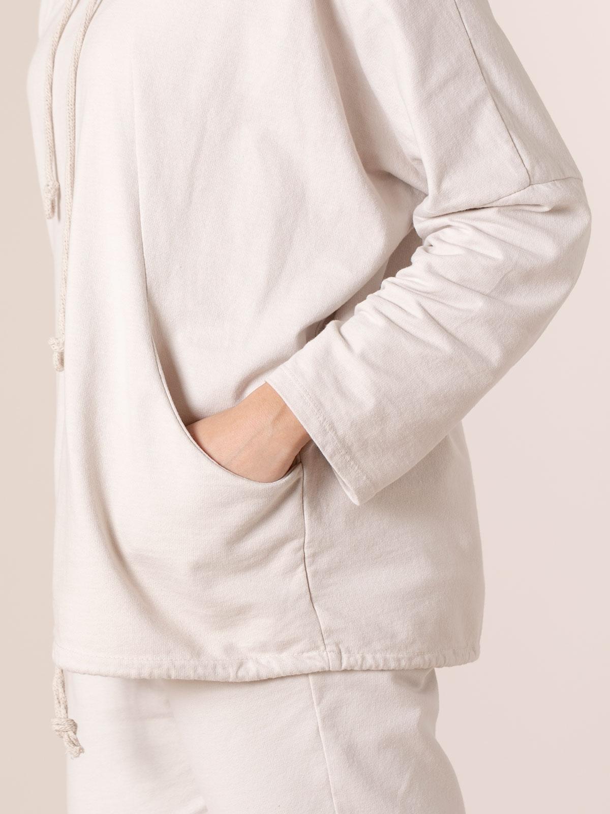 Woman Sweatshirt with pockets and hem detail Beige