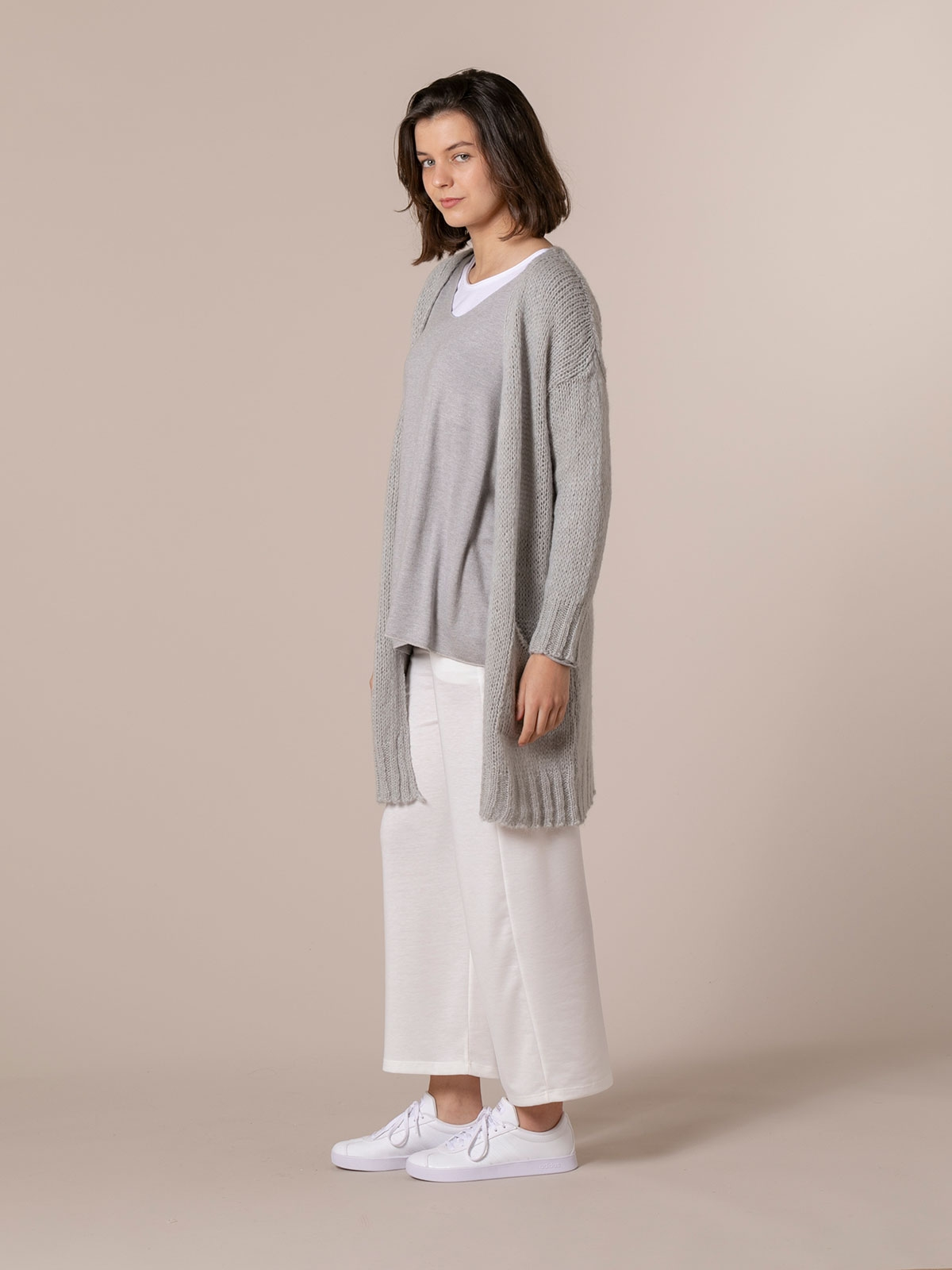 Woman Knitted jacket with valance pockets Grey