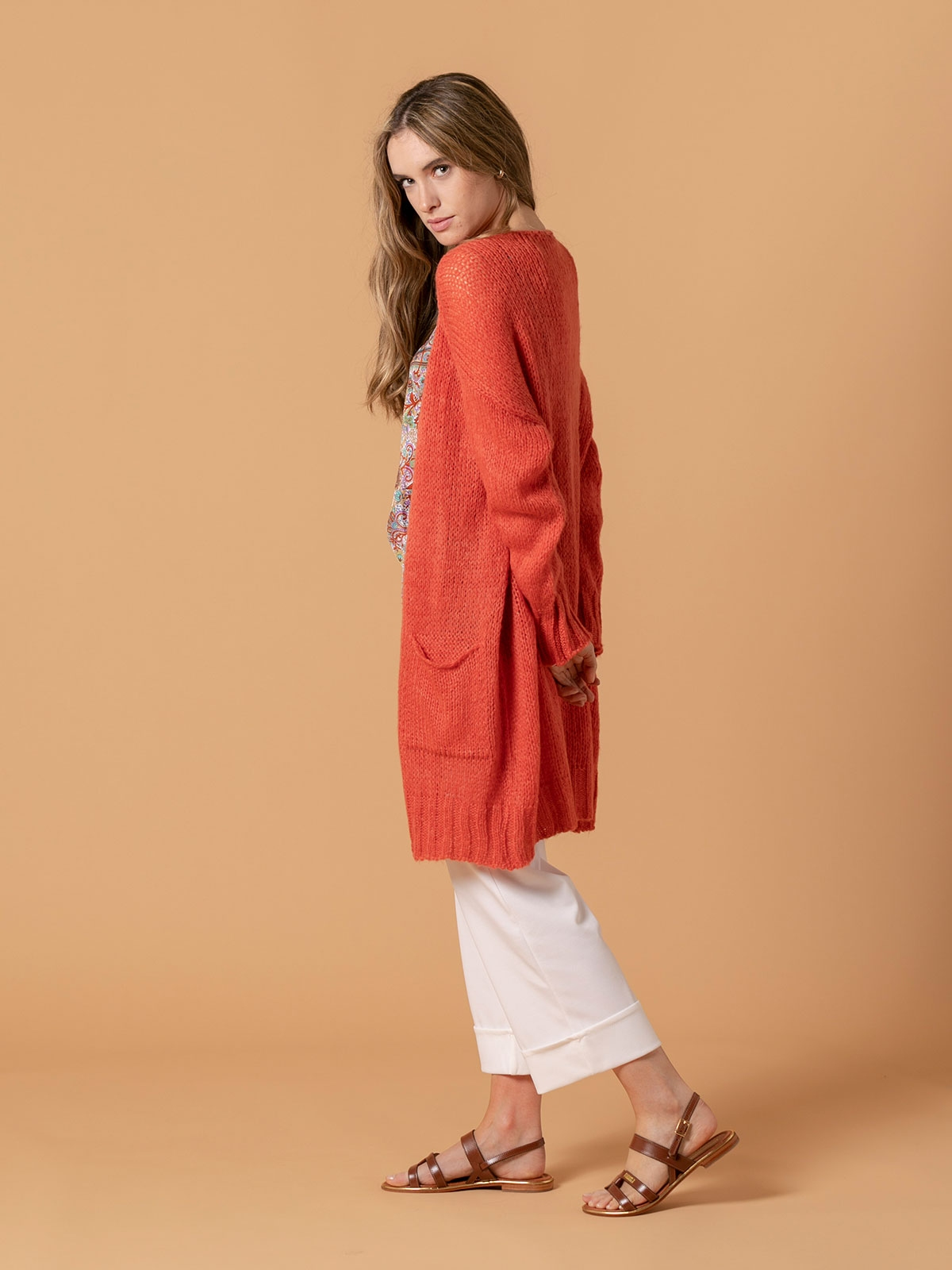 Woman Knitted jacket with valance pockets Coral