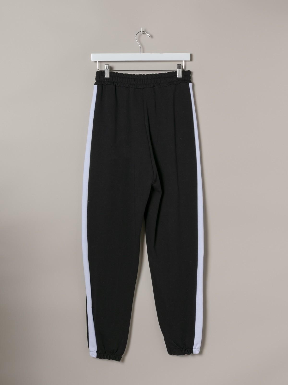 Woman Woman Striped sport pants Black