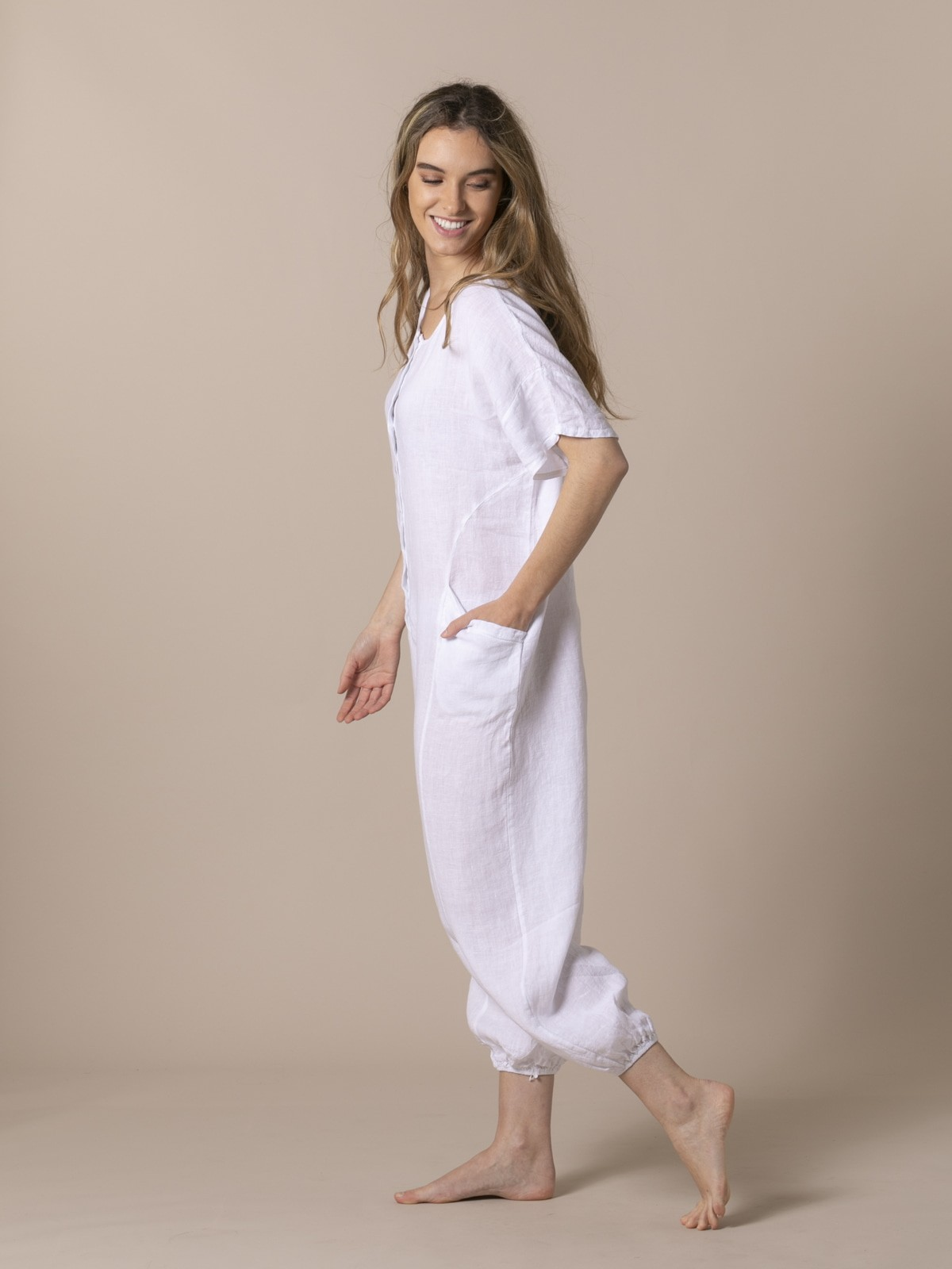 Woman Linen jumpsuit with buttons and elastic hem White
