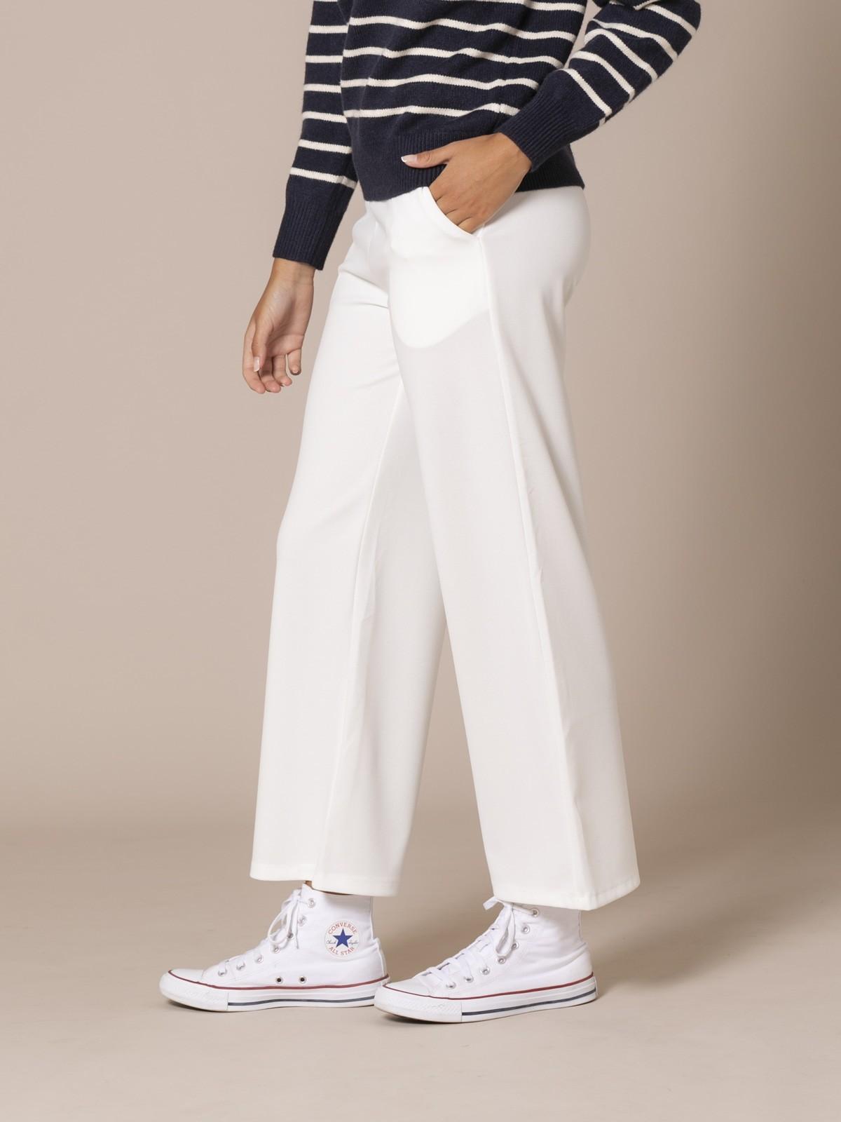 Pantalón mujer de caida con bolsillos Crudo